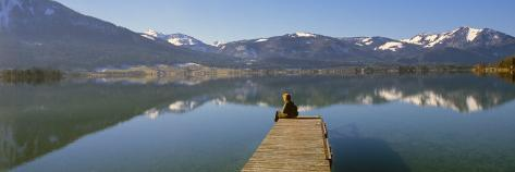 Woman Sitting on a Pier at Lakeside, Wolfgangsee, St. Wolfgang, Salzkammergut, Upper Austria Photographic Print
