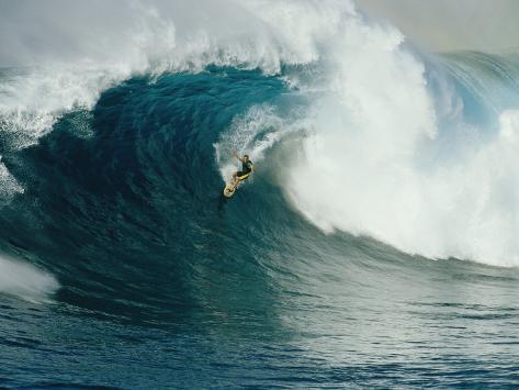 A Surfer Rides a Powerful Wave off the North Shore of Maui Island Photographic Print
