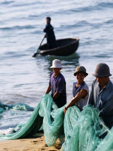 Carrying Fishing Nets Up the Beach after the Day's Work Photographic Print