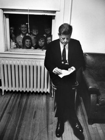 Senator John F. Kennedy Checking over Speech During His Presidential Campaign Photographic Print