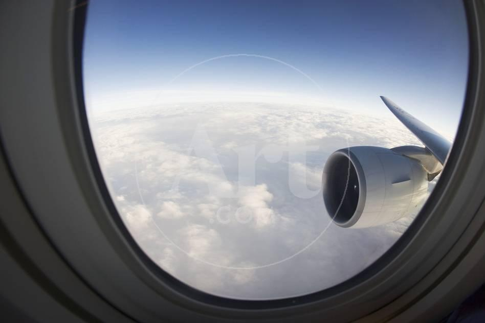 Airplane Window Looking Out On Cloudy Sky Photographic Print