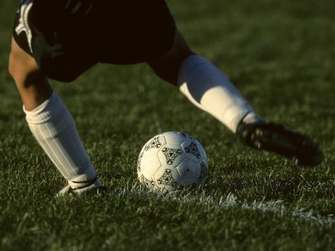 Detail of Foot About to Kick a Soccer Ball Photographic Print
