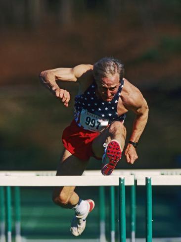 Mature Athlete Competing in Hurdles Race, Atlanta, Georgia, USA Photographic Print