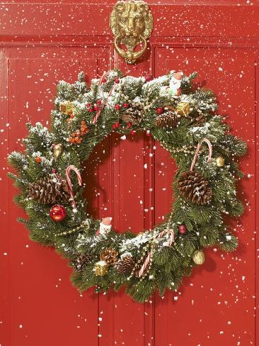 Christmas wreath hanging on a door Photographic Print