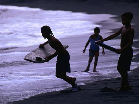 Young Surfers on Black-Sand Beach, French Polynesia Photographic Print