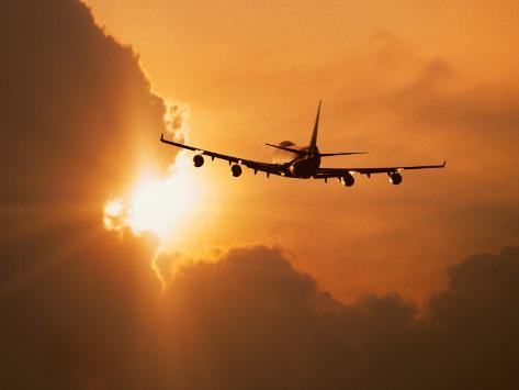 Jumbo Jet Banking Into Sunset Photographic Print