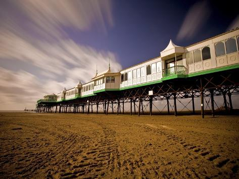 Pier at Lytham St. Annes extends over a sandy beach Photographic Print