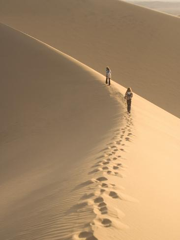 Teenagers Walk on the Mesquite Dunes Near Stovepipe Wells Photographic Print