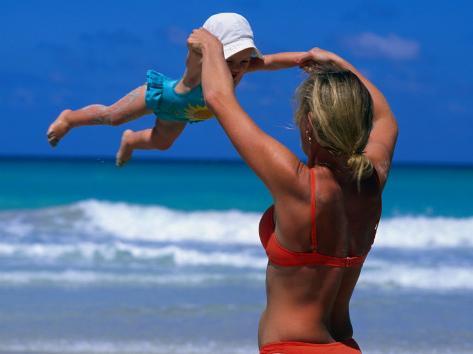 Mother Swinging Baby on Varadero Beach, Varadero, Cuba Photographic Print