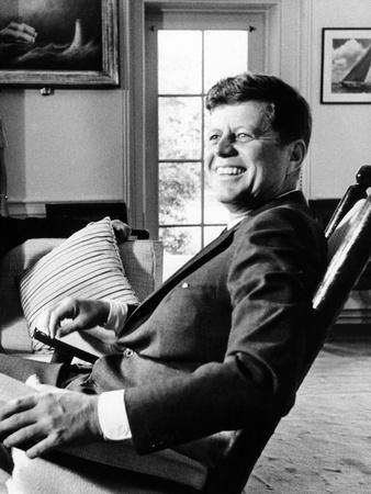 Pres Kennedy Sits In Rocking Chair In Oval Office Of White