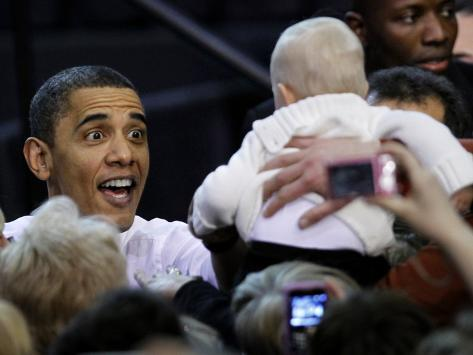 President Barack Obama Smiles at a Baby During His Event at the University of Iowa in Iowa City Photographic Print