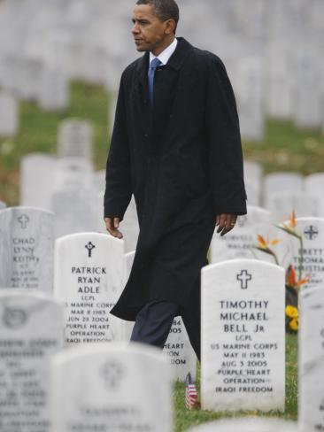 President Barack Obama Walks Through Grave Markers During a Visit to Arlington National Cemetery Stretched Canvas Print