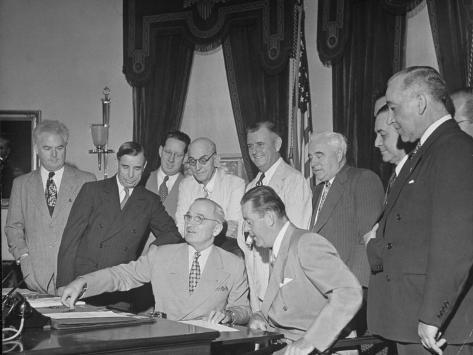 President Harry S. Truman Signing Air-Rate Bill Stretched Canvas Print