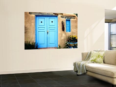 Blue Door on Adobe Building Seinämaalaus