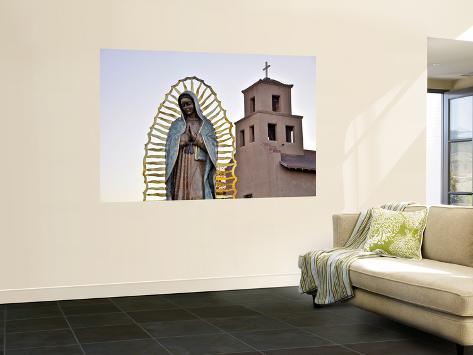 Mother Mary Sculpture with Church Belltower in Background Seinämaalaus