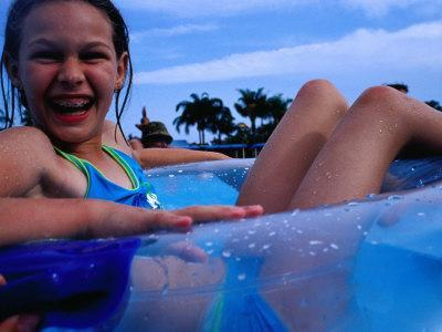 Young Girl Floating In Swimming Pool In Rubber Ring Gold Coast Australia Photographic Print By