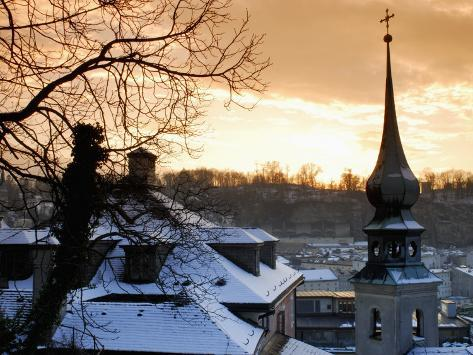 Snow-Covered Rooftops and Tower of Johann Am Imberg with Ridge of Monchsberg Photographic Print