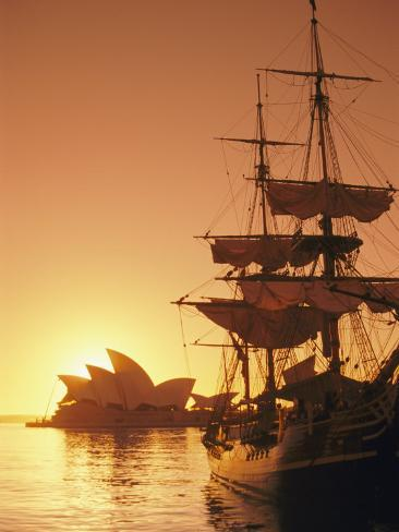 Sydney Opera House and the Hms Bounty, a Replica of the Famous Ship, Silhouetted by the Setting Sun Photographic Print