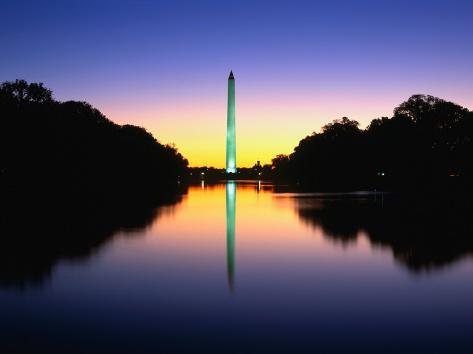 An Illuminated Washington Monument Reflects in the