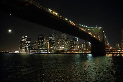 The Brooklyn Bridge Connects to a Bright New York City Night Skyline Photographic Print