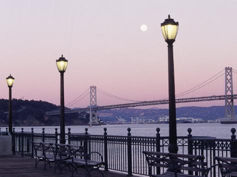 Street Lamps with Bridge in the Background Photographic Print