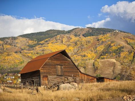 The famous Steamboat Barn, Steamboat Springs Ski Area in the background with yellow aspen trees, Co Photographic Print