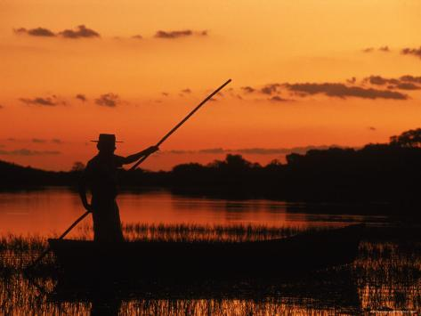 Gaucho Poling Canoe at Sunset, Ibera Marshes National Reserve, Argentina, South America Photographic Print
