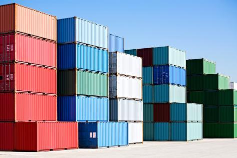 Cargo Shipping Containers Stacked at Harbor Freight Terminal under Clear Blue Sky Photographic Print