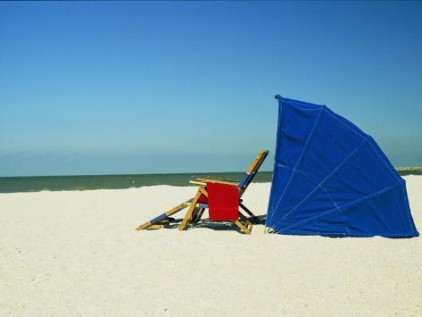 Beach Chair and Umbrella Photographic Print