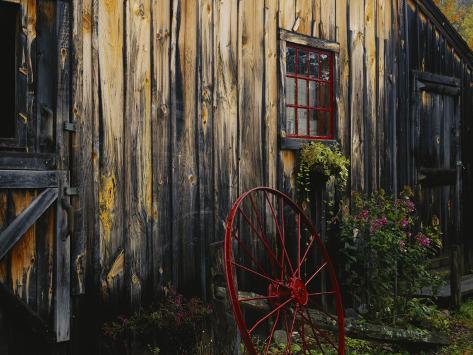 Wheel Besides Barn, Drury Place, Weston, Vermont, USA Photographic Print