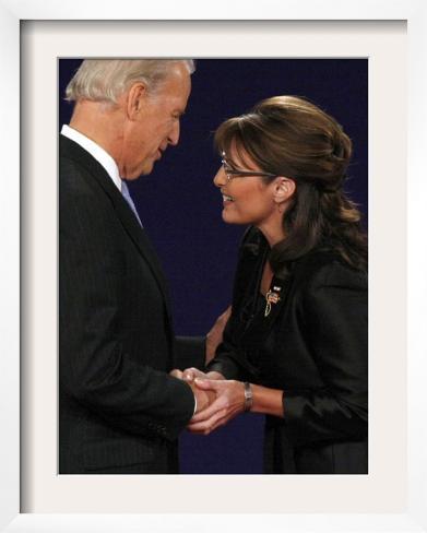 Senator Joe Biden and Governor Sarah Palin Shake Hands before the Start of Vice Presidential Debate Framed Photographic Print