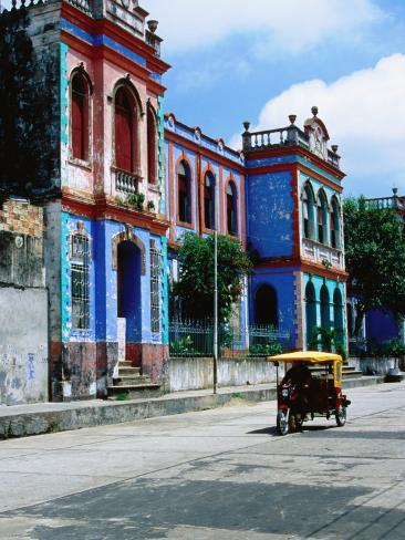 Brightly Coloured Buildings and Motorcycle Taxi Photographic Print