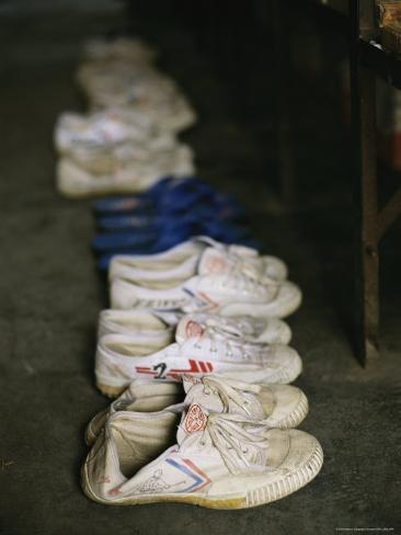 Shoes Lined up Alongside Beds of Kung Fu Students at Ta Gou Academy Photographic Print