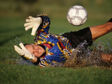 Soccer Goalie in Action Photographic Print