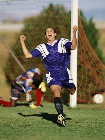 Soccer Player Celebrating after Scoring a Goal Stretched Canvas Print