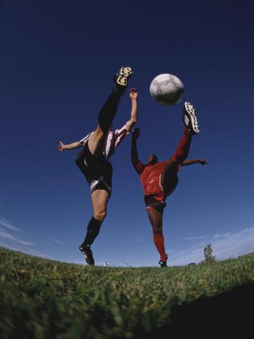 Soccer Players Fighting for the Ball Photographic Print