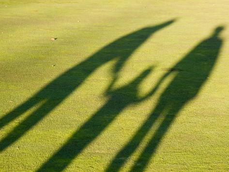 Tall Shadows Loom on the Greens of a Golf Course Photographic Print