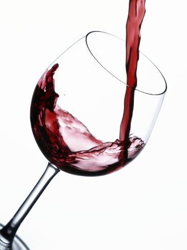 Pouring Red Wine into Wine Glass Photographic Print