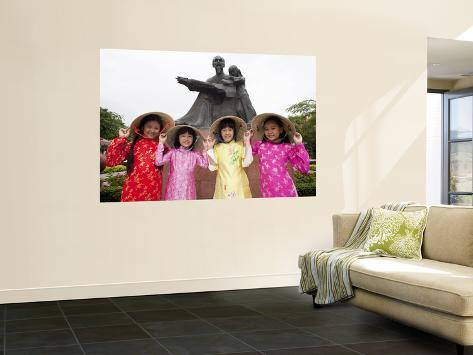 Vietnam, Ho Chi Minh City, Girls Dressed in Traditional Vietnamese Costume Wall Mural