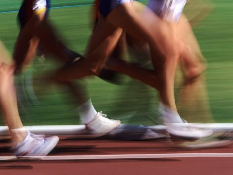 Detail of Blurred Action of Legs in Womens Race Photographic Print