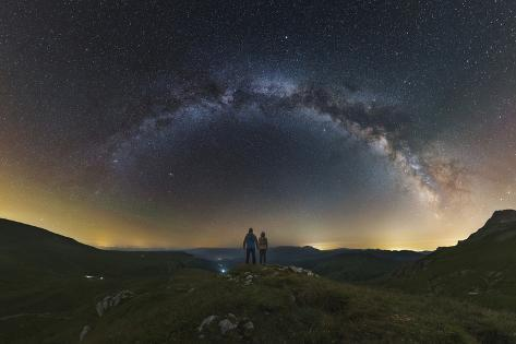 A Couple Gazing at the Milky Way from Atop the Lago-Naki Plateau Overlooking Russia Photographic Print