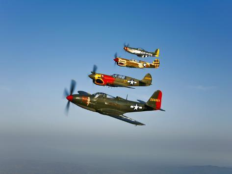 A P-36 Kingcobra, Two Curtiss P-40N Warhawks, and a P-51D Mustang in Flight Photographic Print