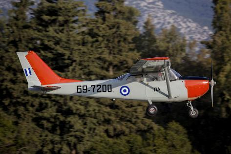 A T-41D Trainer Aircraft of the Hellenic Air Force Flying over Tatoi, Greece Photographic Print