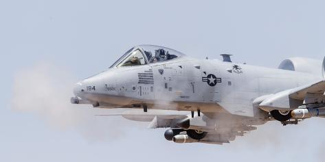 A U.S. Air Force A-10 Thunderbolt Ii Fires its 30Mm Gun at a Strafe Target Photographic Print