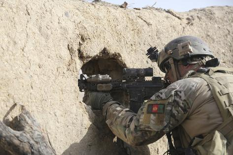 A U.S. Special Forces Soldier Returns Fire from an Outpost in Afghanistan Photographic Print