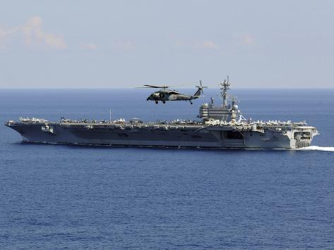 An MH-60S Seahawk Helicopter Flies over USS George H.W. Bush Photographic Print
