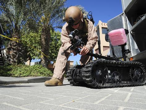 Explosive Ordnance Disposal Technician Prepares a Talon Remote-Controlled Robot Photographic Print