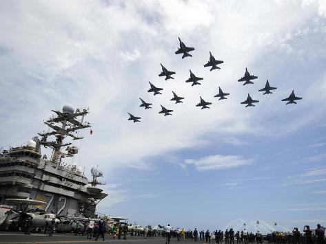 Helicopters Fire Flares As Jets Fly in Formation Above the Flight Deck of USS Abraham Lincoln Valokuvavedos