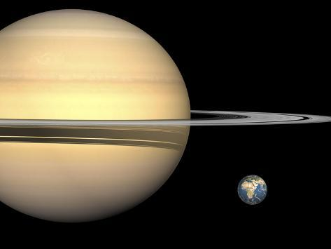 Illustration of Saturn and Earth to Scale Photographic Print