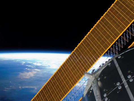 Solar Array Panels on the International Space Station Backdropped Against Earth's Horizon Photographic Print